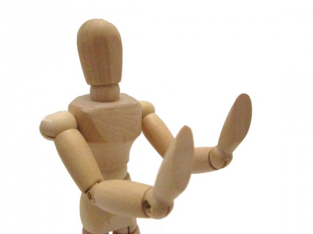 拒否する人形